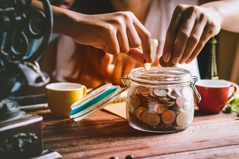 Collecting money in jar